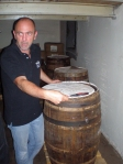Masterblender Andreas Mund of DTM with a barrel of perique