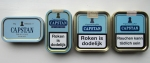 Different Capstan tins FLTR: W.D. & H.O. Wills tin, older Orlik/STG tin, later Orlik/STG tin, MacBaren tin
