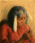 Indian woman smoking pipe