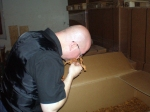 Me sniffing at raw tobacco leaf at the DTM factory
