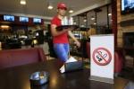 A no-smoking sign and an ashtray.. Hmm..