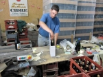 The owner of ferme Belleau packing some bottles of his cider for us